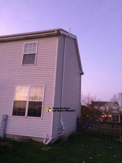 Radon mitigation fixed to an external wall